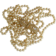 Vintage signed William deLillo flapper length faux pearl necklace crystal clasp