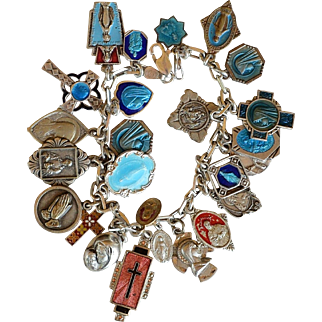 Vintage sterling charm bracelet with religious Catholic medals