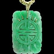 Carved Jadeite & 14 Karat Gold Pendant