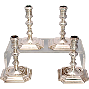 Set of four English Georgian Style Cast Sterling Silver Candlesticks