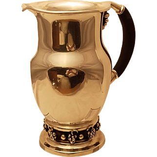 Sterling silver pitcher in style of Georg Jensen grape pattern