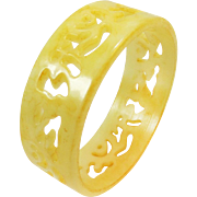 Celluloid bangle bracelet with open-work