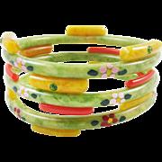 Early Celluloid rhinestone painted bangle bracelets