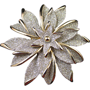 Glittering snowflake floral brooch