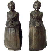 Antique La Belle Chocolatiere Cast Iron Bookends for the Baker Chocolate Company