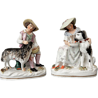Pair of Staffordshire Porcelain Figures of a Boy and Girl with Sheep and Dog