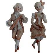 "Pr. Seated German Bisque Porcelain Figurines - ""Boy & Girl"""
