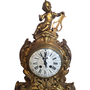 Table clock in Louis XV style