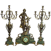 Beautiful French clock set in gold with marble base