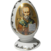 Vintage Russian Stamped Hand Painted Porcelain Egg on Stand Featuring St. Nicholas and the Orthodox Cross.