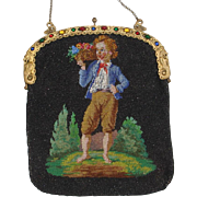 Figural fully Beaded Purse. young man holding flowers, jeweled frame,