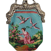 antique Figural fully Beaded Purse. Girl picking flowers, ornate frame