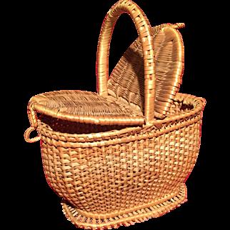 A lovely dolls wicker basket