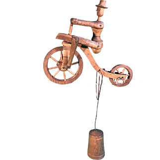 A wooden balancing toy, bicycle on a tightrope
