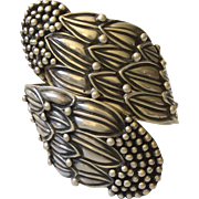 Margot de Taxco Iconic Sterling Silver Repoussé Corn Flower Clamper Bracelet, Hilario Lopez