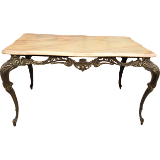 Small metal coffee table with marble top