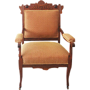 An American walnut and upholstered armchair