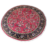A Hand Knotted Wool Rug