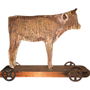 Antique German Miniature Wooden Cow on Wheels