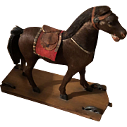 Antique Hide Coveted Cabinet Size Platform Pull Toy Horse