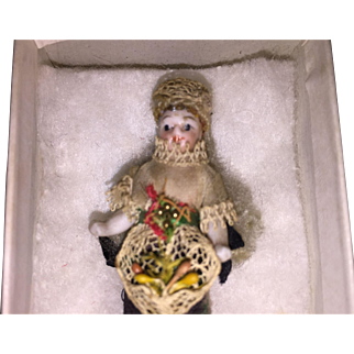 """Antique 2.5"""" All Bisque Miniature Doll with Original Wig and Yellow Boots"""