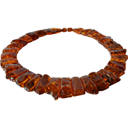 A graduated polished amber necklace, 1970 - 1980.