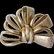 Early vintage silver ( 830 ) Scandinavian bow brooch.
