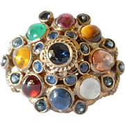 Multi coloured , gold 18k ,cabochon and cut semi and precious gem set Princess ring from Thailand, 1960-1980.