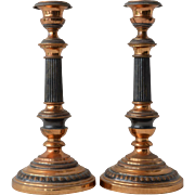A pair of brass and patinated metal candlesticks, mid 20th century.