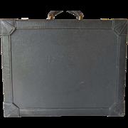 Vintage Hermes briefcase, black leather having red interior, 1960s.