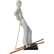 An Art Deco White Pottery Lady Skier, 1920s to 1930s.