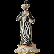 A vintage Capo Di Monte style  standing porcelain clown, 1980c.