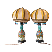 A pair of Plateelbakkerij Zuid-Holland, Gouda pottery Moorish pattern vases, 1923.
