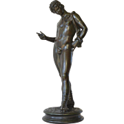 A patinated bronze figure of Narcissus, Italian, late 19th century.
