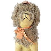 A Soft French Toy Seated Poodle 1920-30s.