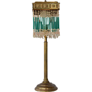 A brass table lamp, 1930c.
