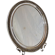 Silver (800) Italian oval dressing table mirror.