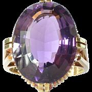 A single stone amethyst set gold ( 14ct ) ring, 1960 - 1980.