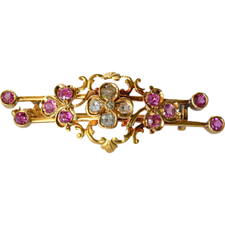 A double bar gold (18ct) brooch with diamond/ruby stone set, early 20th century.