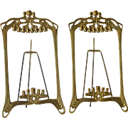 An Art Nouveau pair of polished brass picture frames,1900c.
