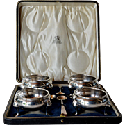 Set of four English sterling silver salt cellars, 1925c.