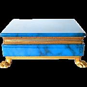 A vintage glass trinket box on gilt frame.