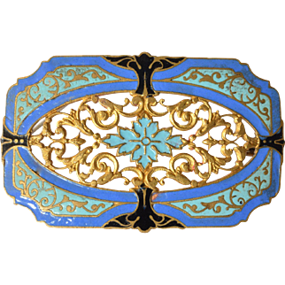 An early vintage enamelled and gilt metal pin brooch.