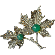 A silver ( 800 ) and marcasite brooch/two green stones, 1930c.