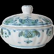 A Koninklijke Porceleyne Fles, Delft circular box and cover, late 19th century.