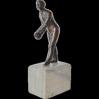A vintage bronze figure of a bowler, 1940 c.