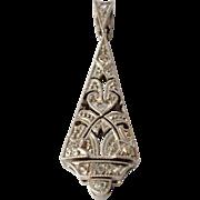A vintage 18ct. white gold pendant with a diamond ( 9 )   set.