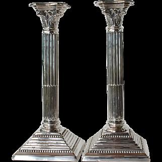 Pair of vintage ' white metal' candlesticks.