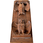 A hand carved oak Brienzer owl folding book rack , 1930c.