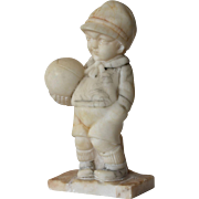 A carved alabaster sculpture of a boy, mid 20th century.